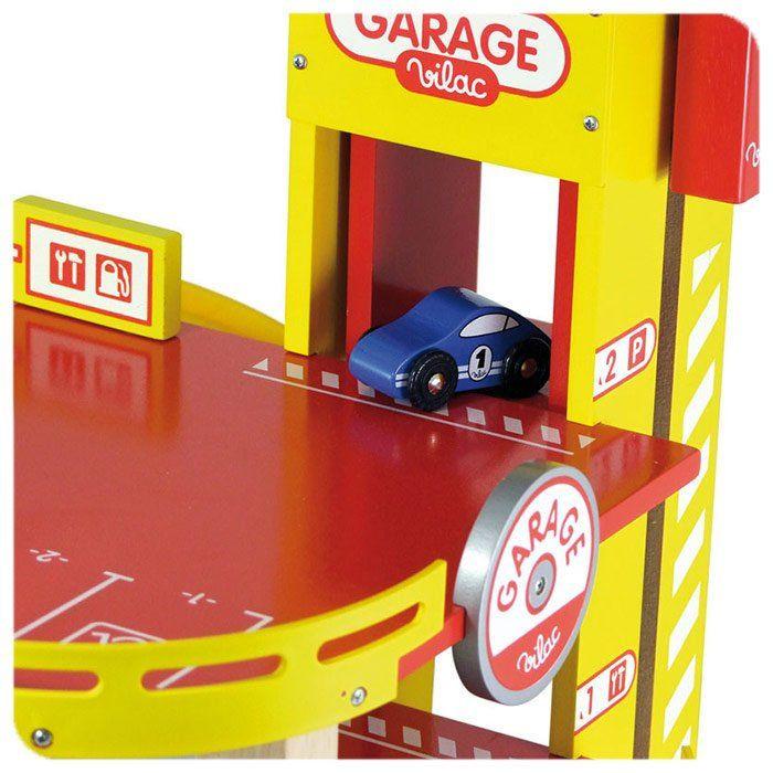 Garage giocattolo a tre piani di vilac un bel regalo per for Bloccare i piani di garage