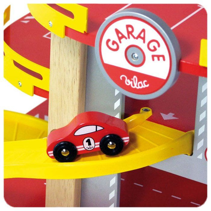 Garage giocattolo a tre piani di vilac un bel regalo per for 2 piani di garage per auto 3 piani